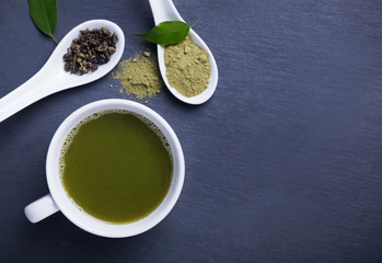 Wall Mural - Matcha tea in a cup, top view