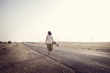 Man travelling alone on country road