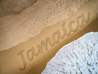 Jamaica written on the beach