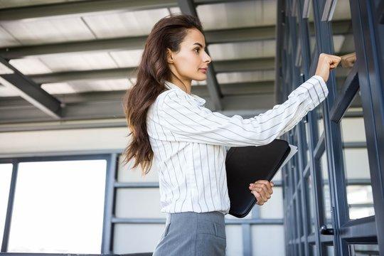 Businesswoman knocking on door