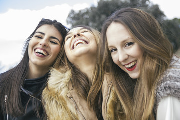 Three laughing young women