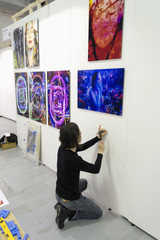 Artist preparing exhibition at art fair