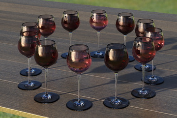 Tasting wine with palette of red, roze and white wines in glasses on the wooden table. Glasses of white wine surrounded by glasses of red and pink wine. 3d illustration
