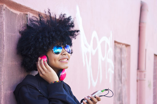 urban girl listening to music