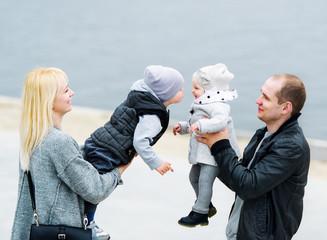 Family walk in city park.