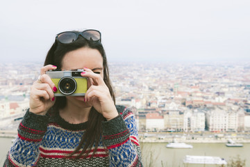 Hungary, Budapest, woman taking a picture from Gellert Hill