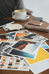 Photo prints on wooden table