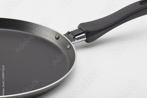 Side view of empty pancake frying pan with teflon coating on