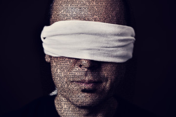 young man with a blindfold in his eyes