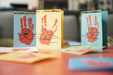 Self-made Easter bunny cards with handprints on a table