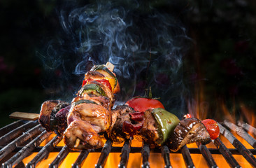 Acrylic Prints Grill / Barbecue Grilled skewers and vegetables, close-up.