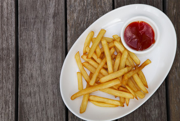 French fries with ketchup on white plate