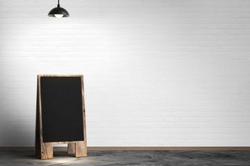 blank blackboard with pendant lamp