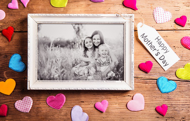 Mothers day composition, picture frame. Studio shot, wooden, bac