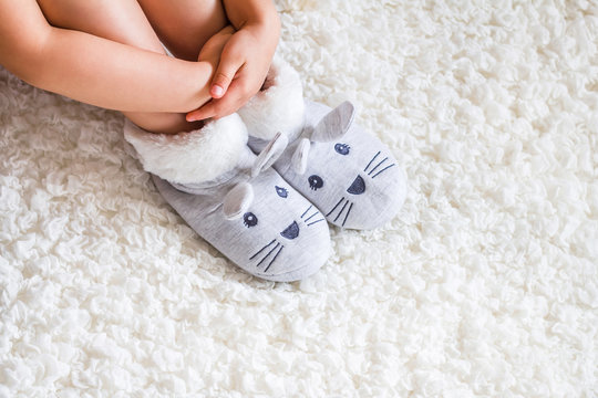 Child. Child's feet in slippers