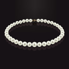 Pearl necklace with reflection on a dark background. With gold claps.