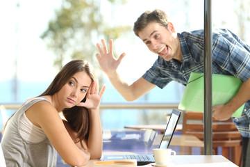 Girl ignoring a stalker man waving