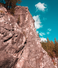 Rock against the blue sky. Outdoors photo.