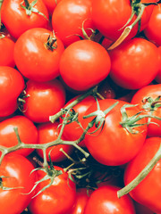 Background with fresh red tomatoes in market. Close up photo.