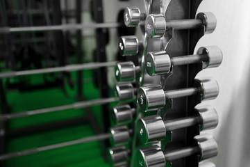 Metal dumbbells lying on gym fitness club