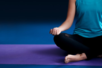 One woman practicing yoga on a mat