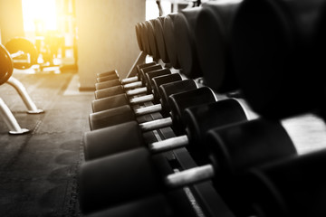 Metal dumbbells lying on gym fitness club
