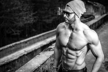 Shirtless man posing outdoor