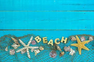 Blank blue wood sign with BEACH, seashells and fish net border