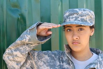 Close-up of ethinc female soldier saluting