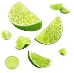Fototapete - Falling limes isolated on white