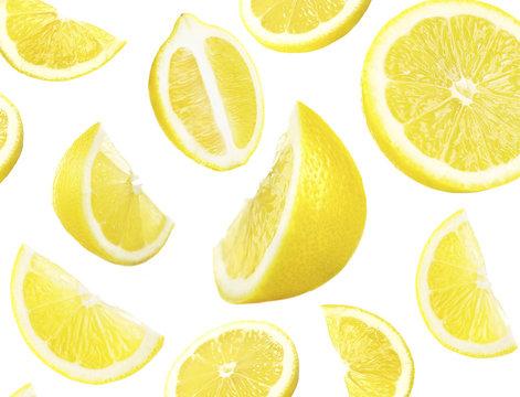 Falling ripe lemons isolated on white