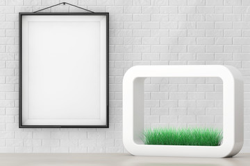 Grass in White Ceramics Planter in front of Brick Wall with Blan