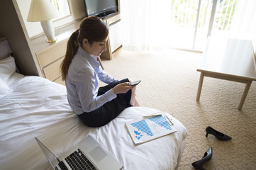 Business women have to check the smart phone in the room before going to work