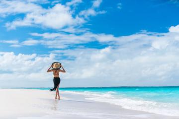 Wall Mural - Luxury summer travel beach woman walking by ocean
