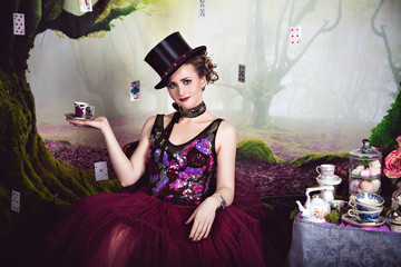 Evil Queen in bowler and a cup of tea
