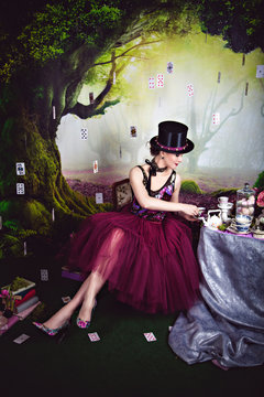 Evil Queen in bowler sitting near the tea table