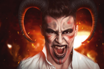 Scary man with horns, hell is preparing for the holiday Halloween