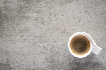 Cup of coffee on a gray concrete table