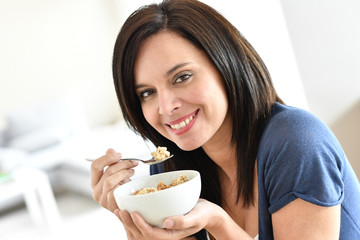 Portrait of mature woman eating cereals