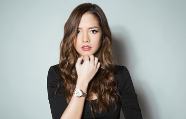 beautiful young asian woman with long hair wearing a wrist watch