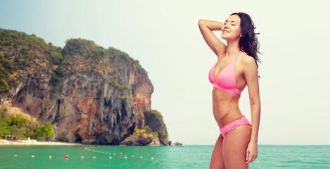 happy young woman in pink bikini swimsuit