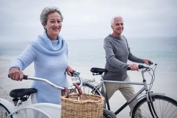 Happy senior couple having ride with their bike
