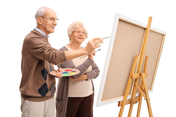 Elderly couple painting together
