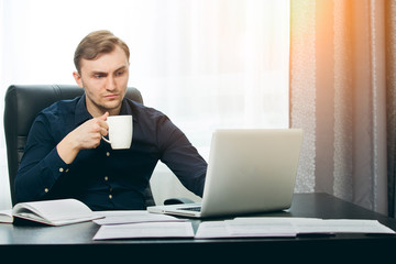 Editor checking new article on his laptop with eyebrow up