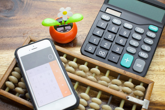 Abacus,calculator with wooden table background