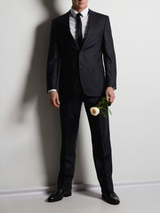 man with flower. groom man in suit and tie.elegant boy without face