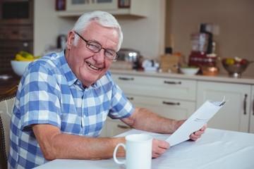 Portrait of senior man with newspaper