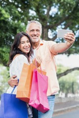 Portrait of couple taking selfie