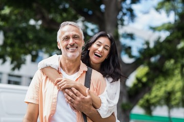 Happy woman hugging man from behind
