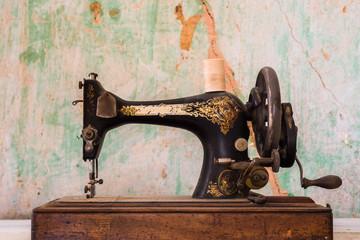 old vintage sewing machine grunge background